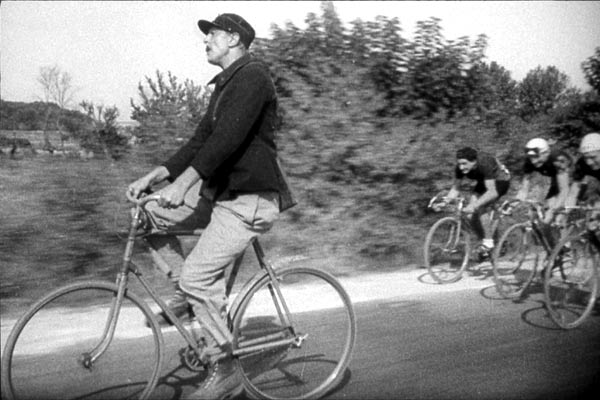 Jacques Tati on his bike